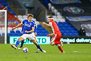 Millwall's Ben Thompson (8) under pressure from Cardiff City's Will Vaulks (6) during the EFL Sky Bet Championship match between Cardiff City and Millwall at the Cardiff City Stadium, Cardiff, Wales on 30 January 2021.