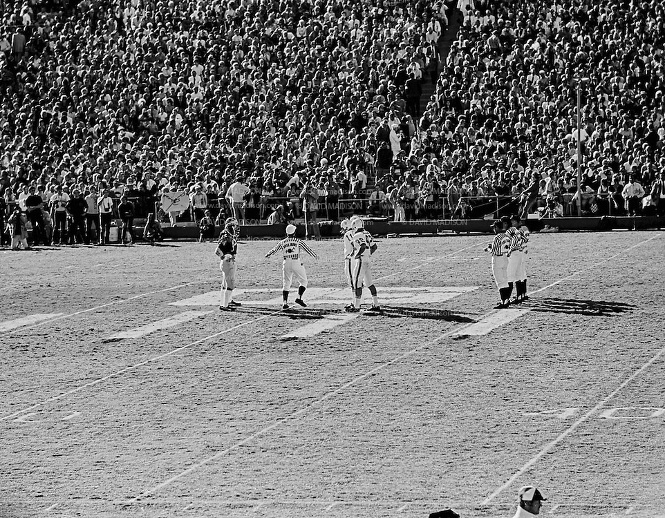 COLLEGE FOOTBALL:  The opening coin toss of the 1972 Rose Bowl between Michigan and Stanford played on January 1, 1972 at the Rose Bowl in Pasadena, California. Stanford won by a score of 13-12.  Visible players include Stanford's Don Bunce #11 and Jeff Siemon #92.  BW R 0147