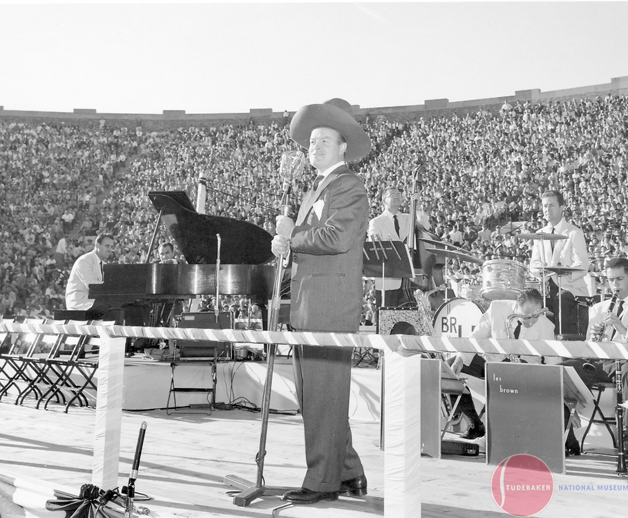 Bob Hope entertains at the Studebaker-Packard merger rally at Notre Dame Stadium, October 1954