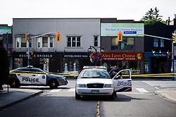 Police are shown at the perimeter of the scene of a shooting in east Toronto, on Monday, July 23, 2018. Police were trying Monday to determine what prompted a 29-year-old man to go on a shooting rampage in a popular Toronto neighbourhood, killing two people and injuring 12 others. THE CANADIAN PRESS/Christopher Katsarov
