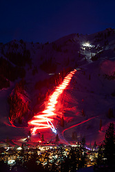 """""""Squaw Valley Torchlight Parade 1"""" - Long exposure photograph of the torchlight parade at Squaw Valley Ski Resort. Multiple skiers hold torches at they ski down the mountain."""