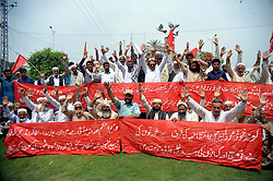 April 30, 2019 - Pakistan - PESHAWAR, PAKISTAN, APR 29: Activists of Mazdoor Kisan Party are holding protest .demonstration for acceptance of their demands, outside Khyber Pakhtunkhwa Assembly building .in Peshawar on Monday, April 29, 2019. (Credit Image: © PPI via ZUMA Wire)