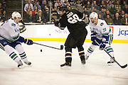 Jaromir Jagr (68) of the Dallas Stars fights for the puck against Christopher Tanev (8) and Chris Higgins (20) of the Vancouver Canucks Thursday, February 21, 2013 at the American Airlines Center in Dallas, Texas. (Cooper Neill/The Dallas Morning News)