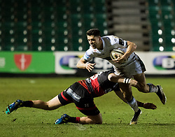 Glasgow Warriors' Adam Hastings is tackled by Dragons' Tyler Morgan<br /> <br /> Photographer Simon King/Replay Images<br /> <br /> Guinness PRO14 Round 14 - Dragons v Glasgow Warriors - Friday 9th February 2018 - Rodney Parade - Newport<br /> <br /> World Copyright © Replay Images . All rights reserved. info@replayimages.co.uk - http://replayimages.co.uk