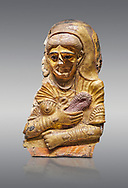Ancient Egyptian Roman female mummy mask, limestone, Roman Period, 2nd Cent AD, Hawara,  Egyptian Museum, Turin. Grey Background<br /> <br /> This is a remarkable gilt cartonnage with inlaid cystal eyes . The woman wears a Roman style hardo half covered by a veil, a himation, fringed cloak, yied to her breat, snake shaped bracelets and a necklace of pink flowers, all of which are connected to the cult of Isis. .<br /> <br /> If you prefer to buy from our ALAMY PHOTO LIBRARY  Collection visit : https://www.alamy.com/portfolio/paul-williams-funkystock/ancient-egyptian-art-artefacts.html  . Type -   Turin   - into the LOWER SEARCH WITHIN GALLERY box. Refine search by adding background colour, subject etc<br /> <br /> Visit our ANCIENT WORLD PHOTO COLLECTIONS for more photos to download or buy as wall art prints https://funkystock.photoshelter.com/gallery-collection/Ancient-World-Art-Antiquities-Historic-Sites-Pictures-Images-of/C00006u26yqSkDOM