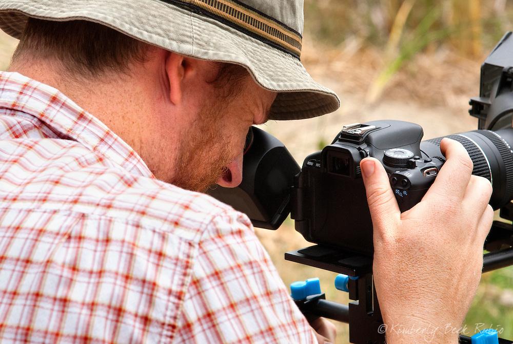 Cameraman filming outdoors.