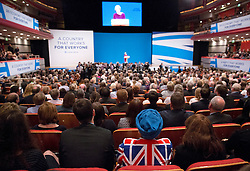 A black member of the audience wears an Union Jack jacket during Prime Minister Theresa May's speech to delegates in the final day of the Conservative party conference at the International Convention Centre, ICC, Birmingham. Wednesday October 5, 2016. Photo credit should read: Isabel Infantes / EMPICS Entertainment.