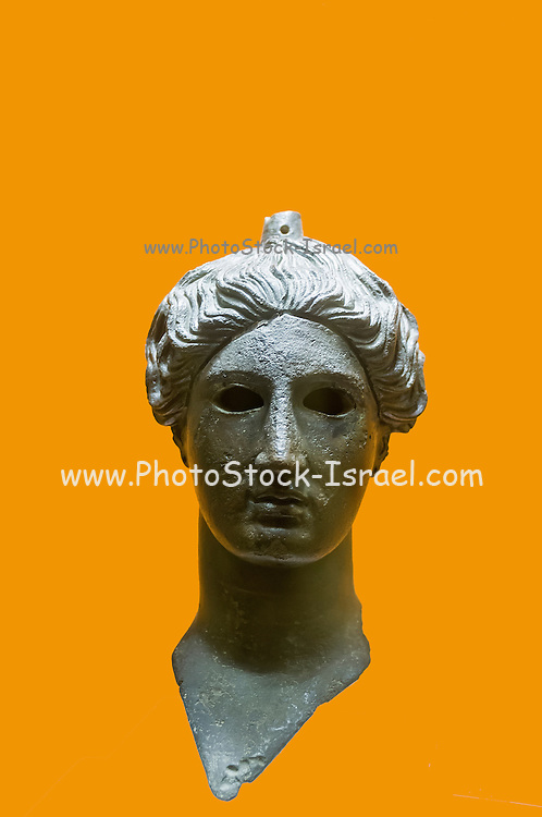 Greece, Athens, The Greek Agora museum in the Stoa of Attalos. Bronze head of Nike (victory) 420 BCE Orange background
