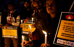 November 18, 2018 - A large crowd of people attend a vigil to remember the victims of road accidents in Srinagar, in Indian administered Kashmir on the occasion of the World Day of Remembrance for Road Traffic Victims on 18th November 2018. Participants hold banners calling for the government to make and enforce good roads safety laws, to ensure roads and vehicles are safe, and to provide prompt emergency care for road traffic victims. According to the Indian ministry of road transport and highways, the Indian State of Jammu and Kashmir ranks second across India for road accidents, with an average of over 900 deaths every year in the last five years and with 5000 accidents in 2017 alone (Credit Image: © Muzamil Mattoo/IMAGESLIVE via ZUMA Wire)