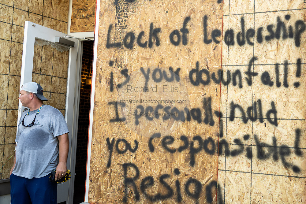 Charleston, United States. 31 May, 2020. A shop owner painted a message to the mayor on the boarded up store front on the King Street shopping district after a protest over the death of George Floyd, turned violent and destructive May 31, 2020 in Charleston, South Carolina. Floyd was choked to death by police in Minneapolis resulting in protests sweeping across the nation.  Credit: Richard Ellis/Alamy Live News