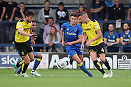 AFC Wimbledon Anthony Hartigan (26) closing down and tackling during the Pre-Season Friendly match between AFC Wimbledon and Burton Albion at the Cherry Red Records Stadium, Kingston, England on 21 July 2017. Photo by Matthew Redman.