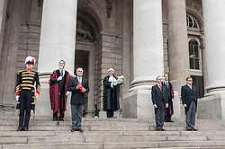 © Licensed to London News Pictures. 30/03/2015. Royal Exchange, Cornhill, London, UK. Following the dissolution of Parliament earlier today, by tradition, the Common Crier of the City reads out a copy of the Royal Proclamation, summoning a new Parliament and requiring an election, on the steps of the Royal Exchange, having been it handed to him by the Common Serjeant of the City, ahead of it being also read out in the London boroughs. Photo credit : Stephen Chung/LNP