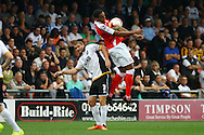 Crewe Alexandra's Vadaine Oliver chests the ball under pressure from Port Vale's Carl Dickinson. Skybet football league one match, Crewe Alexandra v Port Vale at the Alexandra Stadium in Crewe on Saturday 13th Sept 2014.<br /> pic by Chris Stading, Andrew Orchard sports photography.