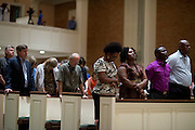 Visitors pray during a memorial service for Ebola patient Thomas Eric Duncan at Wilshire Baptist Church on October 8, 2014, in Dallas. (Cooper Neill for The New York Times)