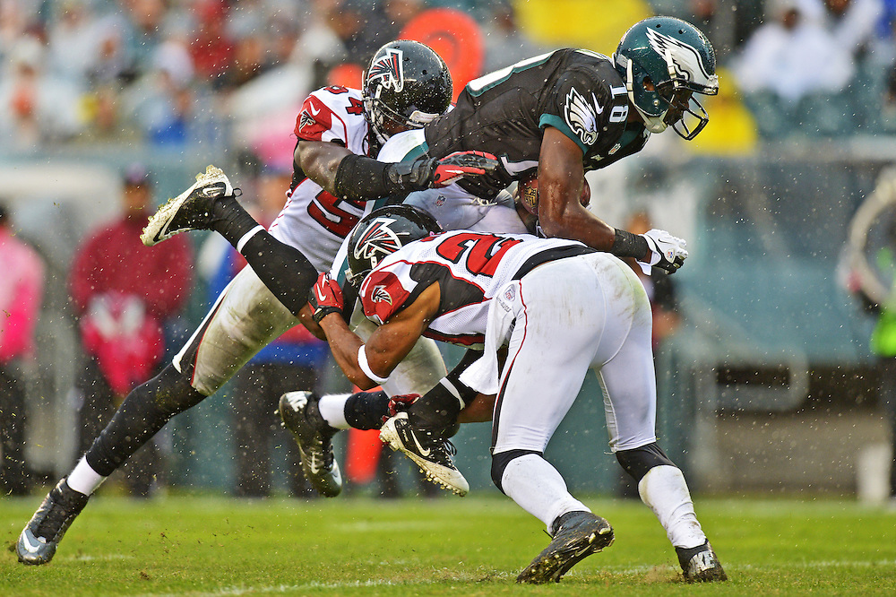 PHILADELPHIA, PA - OCTOBER 28: Jeremy Maclin #18 of the Philadelphia Eagles is tackled by Stephen Nicholas #54 and Robert McClain #27 of the Atlanta Falcons at Lincoln Financial Field on October 28, 2012 in Philadelphia, Pennsylvania. The Falcons won 30-17. (Photo by Drew Hallowell/Philadelphia Eagles/Getty Images) *** Local Caption ***  Jeremy Maclin;Stephen Nicholas;Robert McClain