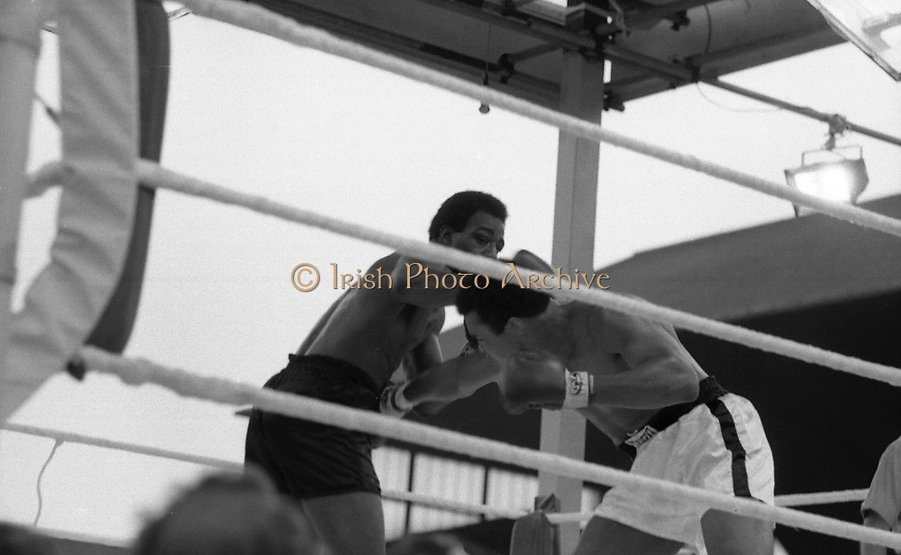 Ali vs Lewis Fight, Croke Park,Dublin.<br /> 1972.<br /> 19.07.1972.<br /> 07.19.1972.<br /> 19th July 1972.<br /> As part of his built up for a World Championship attempt against the current champion, 'Smokin' Joe Frazier,Muhammad Ali fought Al 'Blue' Lewis at Croke Park,Dublin,Ireland. Muhammad Ali won the fight with a TKO when the fight was stopped in the eleventh round.<br /> <br /> Image of Lewis throwing a left as Ali ducks to avoid the blow.