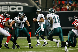 Philadelphia Eagles quarterback Donovan McNabb #5 looks for a receiver during the NFL game between the Philadelphia Eagles and the Atlanta Falcons on December 6th 2009. The Eagles won 34-7 at The Georgia Dome in Atlanta, Georgia. (Photo By Brian Garfinkel)