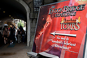 London Tombs at the London Bridge Experience. A horror attraction based on the idea of the London Dungeons. Workers draw in tourists here made up in costumes with lots of fake blood.