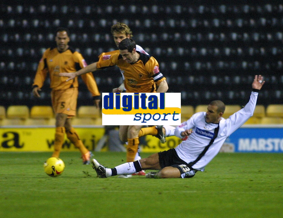 Photo: Dave Linney.<br />Derby County v Wolverhampton Wanderers. Coca Cola Championship. 18/11/2005. Mark Kennedy (Wolves) escapes the challenge of Marcus Tudgay(Derby)