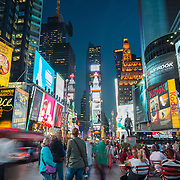 People gathering in TImes Square at night