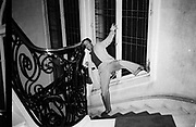 Silver gelatine print of Peter mucking about on the stairs before lunch with JJ Naudet in Paris in 1984