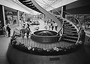 Y-630427A- C10.  Spiral Staircase. Lloyd Center, April 27, 1963 (This used to be the stairs to the administration offices, before there was a roof on the mall)