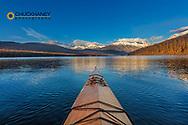 Sea kayaking on Kintla Lake in late autumn in Glacier National Park, Montana, USA model released
