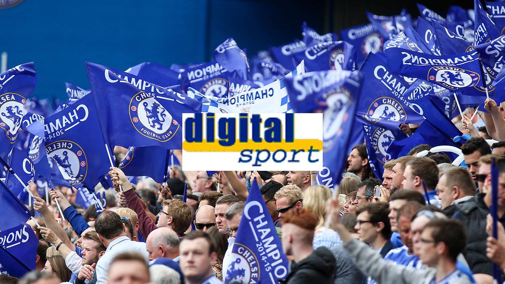 Football - 2014 / 2015 Premier League - Chelsea vs. Sunderland.   <br /> <br /> Chelsea fans wave flags in celebration at their title win at Stamford Bridge. <br /> <br /> COLORSPORT/DANIEL BEARHAM