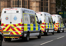 © Licensed to London News Pictures. 09/10/2019. London, UK. Police vans from Surrey and Sussex Constabularies are parked up outside Parliament as Extinction Rebellion activists take part in a third day of protests in central London. The climate change group intend to blockade the Westminster area for two weeks to demand that the government takes immediate and decisive action on climate change. Photo credit: Peter Macdiarmid/LNP