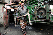 Gwyn Evans, 48, a miner working to restore the safety and quality of the underground passage to Unity Mine, on Wednesday, Apr. 11, 2007, in Cwmgwrach, Vale of Neath, South Wales. The time is ripe again for an unexpected revival of the coal industry in the Vale of Neath due to the increasing prize and diminishing reserves of oil and gas, the uncertainties of renewable energy sources, and the technological advancement in producing energy from coal while limiting emissions of pollutants, has created the basis for valuable investment opportunities and a possible alternative to the latest energy crisis. Unity Mine, in particular, has started a pioneering effort to revive the coal industry in the area, reopening after more than 8 years with the intent of exploiting the large resources still buried underground. Coal could be then answer to both, access to cheaper and paradoxically greener energy and a better and safer choice than nuclear energy as a major supply for the decades to come. It is estimated that coal reserves in Wales amount to over 250 million tonnes, or the equivalent of at least 50 years of energy supply, while the worldwide total coal could last for over 200 years as a viable resource compared to only a few decades of oil and natural gas.