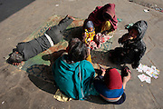 A family struggles to survive living at the train station in Jaipur.  Children, some who have run away from their families, find themselves living homeless on the train tracks waititng for the next train to arrive at the train station in Jaipur, India.  Once the train arrives they raid the train looking for plastic bottles that they can then sell.  Most will make about $1.50/day but spend most of it on glue which they are most addicted to.