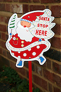 Santa stop here sign outside house