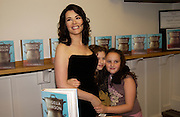 Nigella Lawson with her daughters Mimi and Phoebe ( pink skirt) i, 'Feast Food that celebrates Life' by Nigella Lawson- book launch. Cadogan Hall, Sloane Terace. 11 October 2004. ONE TIME USE ONLY - DO NOT ARCHIVE  © Copyright Photograph by Dafydd Jones 66 Stockwell Park Rd. London SW9 0DA Tel 020 7733 0108 www.dafjones.com
