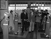"""President Hillery at The Community Games..1979..15.09.1979..09.15.1979..15th September 1979..President Patrick Hillery attended the opening of The National Community Games finals at Mosney, Co Meath today. The finals were held in the grounds of The Butlins Holiday Centre and were sponsored by Tayto Irl Ltd,Greencastle Road,Coolock,Dublin..Image shows Mr William Walshe,National President,Community Games leading president Hillery into the games reception area. young """"Tayto"""" girls form a guard of honour."""