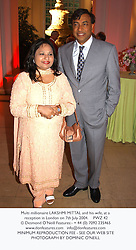 Multi millionaire LAKSHMI MITTAL and his wife, at a reception in London on 7th July 2004.PWZ 42