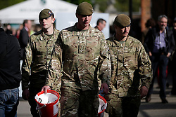 © Licensed to London News Pictures. 23/05/2013. London, UK Soldiers collect money for the Help for Heroes charity at the RHS Chelsea Flower Show, the day after a soldier was killed by alleged Islamic extremists in Woolwich. Photo credit : LNP
