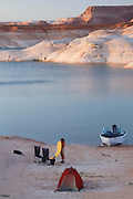 Boat camping in West Canyon, Lake Powell, Glen Canyon National Recreation Area, Page, Arizona.