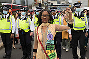 Bhavini Patel of XR Unify leads environmental activists from Extinction Rebellion on an Impossible Tea Party march through the City of London on 30th August 2021 in London, United Kingdom. Extinction Rebellion were drawing attention to financial institutions funding fossil fuel projects whilst calling on the UK government to cease all new fossil fuel investment with immediate effect on the eighth day of their Impossible Rebellion protests in London.