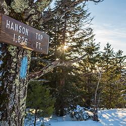 The sign marking Hanson Top on Green Mountain in Effingham, New Hampshire. Winter.
