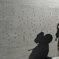 Soldier visits the newly inaugurated Memorial of Unity that is decorated with names of Hungarian towns (many of them belonging to neighbouring countries since the Treaty of Trianon) engraved onto the walls on the national holiday celebrating the foundation of the Hungarian State in Budapest, Hungary  on Aug. 20, 2020. ATTILA VOLGYI