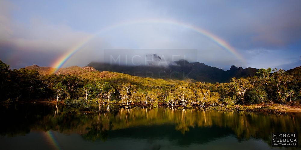 A panoramic photograph of a rainbow over Mt Bowen and Little Ramsay Lagoon on Hinchinbrook Island<br /> <br /> Open Edition Print / Stock Image