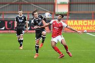 Crawley Town midfielder Sam Matthews (20) battles with Conor Thomas (7) of Cheltenham Town during the EFL Sky Bet League 2 match between Cheltenham Town and Crawley Town at Jonny Rocks Stadium, Cheltenham, England on 10 October 2020.