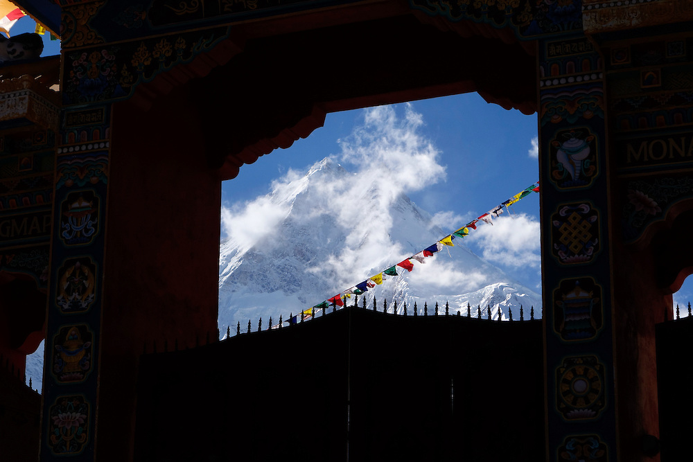 View of Manaslu peak through the entrance to the new monastary in Lho, Nepal.