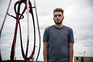 'Untitled, 2014' from the project 'The Fall and Rise of Ravenscraig' by photographer Colin McPherson.<br /> <br /> Dylan Simpson, 18, a 'second chances' student apprentice at New College Lanarkshire, which stands on the site of the former steelworks at Ravenscraig.<br /> <br /> This project, photographed in 2014, looks at the topography of the post-industrial landscape at Ravenscraig, the site until its closure in 1992 of the largest hot strip steel mill in western Europe. In its current state, Ravenscraig is one of the largest derelict sites in Europe measuring over 1,125 acres (4.55 km2) in size, an area equivalent to 700 football pitches or twice the size of Monaco. It is currently being developed with a mix of housing, retail and the home of South Lanarkshire College and the Ravenscraig Regional Sports Facility.