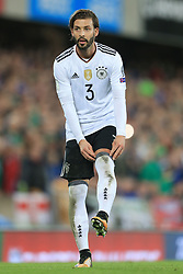 5th October 2017 - 2018 FIFA World Cup Qualifying (Group C) - Northern Ireland v Germany - Marvin Plattenhardt of Germany pulls his socks up - Photo: Simon Stacpoole / Offside.