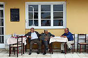 Greece, Thessaly, Agia Kiriaki, a little fishing village at the south west point of the peninsula Pelion. Local people in a cafe