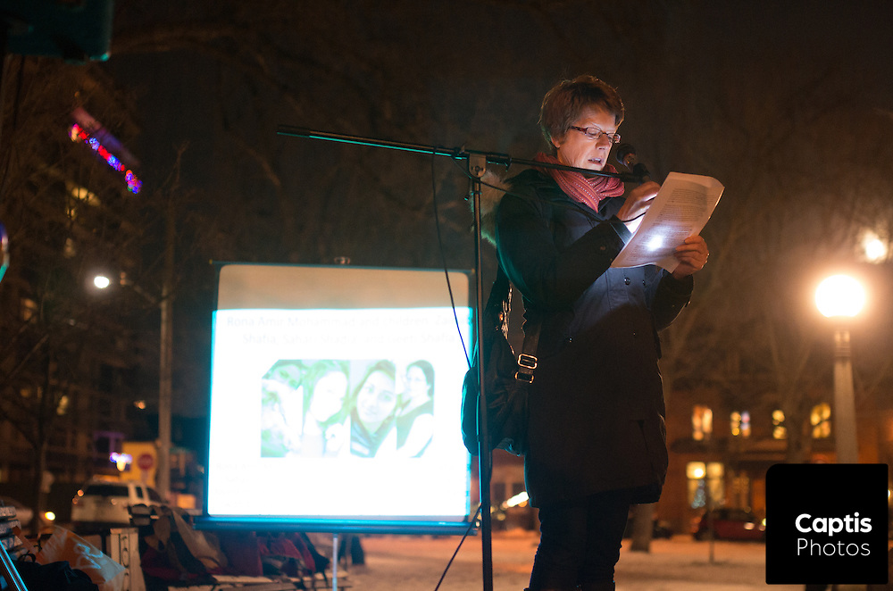 A women speaks to people in attendance of a vigil honouring the victims of the Ecole Polytechnique Shooting. December 6, 2014.