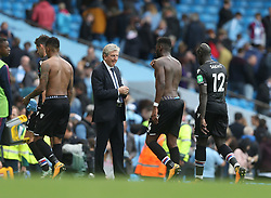 23 September 2017 Manchester : Premier League Football : Manchester City v Crystal Palace:  Palace manager Roy Hodgson stares past his defeated players as they depart the pitch.<br /> Photo: Mark Leech