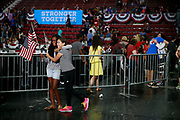 07292016 - Philadelphia, Pennsylvania, USA: Jahzaria James (gray shirt) and Angel James play with American flags after Hillary Clinton's first campaign stop after the Democratic National Convention at Temple University in Philadelphia, Pennsylvania. (Jeremy Hogan/Polaris)