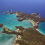 An aerial view of secluded beaches in the Bay of Islands, North Island, New Zealand. .The Bay of Islands boasts a unique coastline sheltering over 150 small islands in its arms. Once a seafaring and whaling region the Bay of Islands is today a popular tourist destination recognised for it's cultural heritage as well as it's amazing scenery and wildlife. Small towns are scattered along the coastline. There are a lot of water-based activities, including kayaking, swimming with dolphins, game fishing and boating and whales and dolphins can often be seen in the bay. Bay of Islands, New Zealand, 16th November 2010. Photo Tim Clayton.